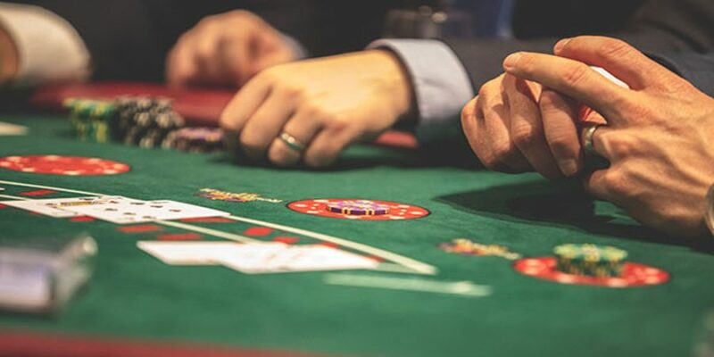 Players at the blackjack table.